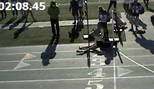 Masked High School Runner Faceplants at Finish Line